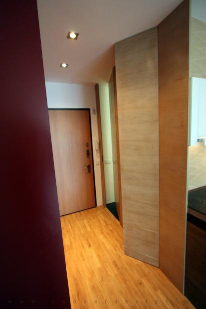 garzonlakás belsőépítészete, harmónikaszerűen elhúzható üvegfal a fürdőszoba leválasztására