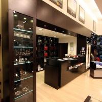 Reálszisztéma Menedzser Shop belsőépítészete, pénztárpult