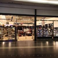 Reálszisztéma Menedzser Shop belsőépítészete, kirakati portál
